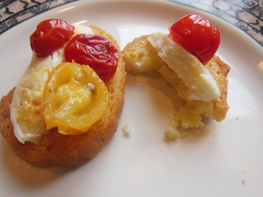 Great summer treat, Crunchy crostini topped with fresh mozzarella and roasted tomatoes.